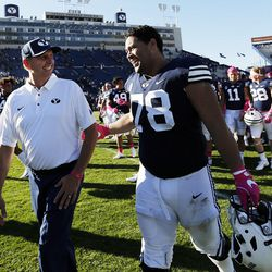 Offensive coordinator and quarterbacks coach Ty Detmer talks with Brigham Young Cougars offensive lineman Tuni Kanuch following NCAA football in Provo on Saturday, Oct. 28, 2017.
