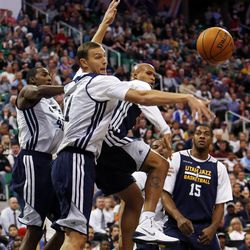 Andris Biedrins reaches to block a shot as Richard Jefferson passes off during the Utah Jazz's scrimmage in Salt Lake City, Saturday, Oct. 5, 2013.