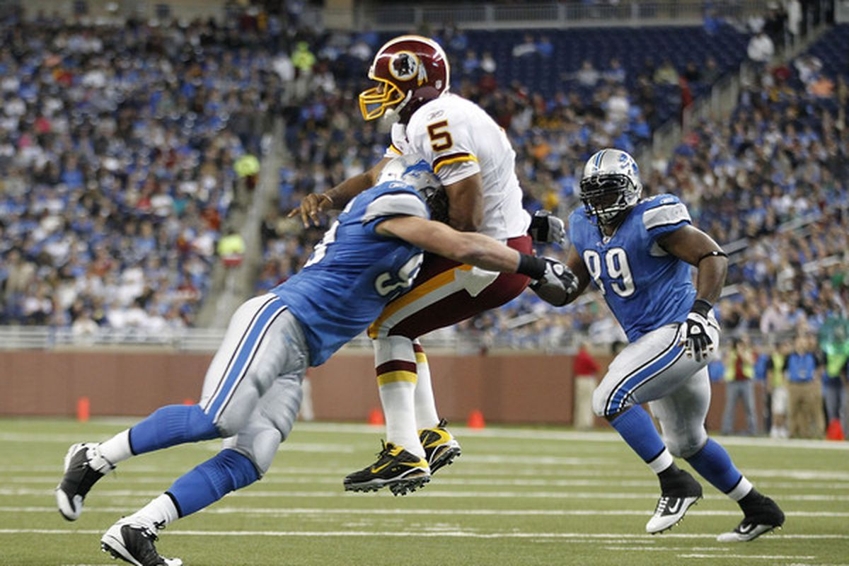 DETROIT - OCTOBER 31: Kyle Vanden Bosch #93 of the Detroit Lions hits Donovan McNabb #5 of the Washington Redskins during the first quarter of the game at Ford Field on October 31 2010 in Detroit Michigan. (Photo by Leon Halip/Getty Images)