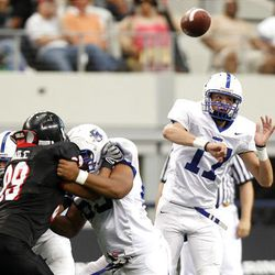 Bingham quarterback Ty Hannay delivers a pass as the Miners play Euless (Texas) Trinity Monday in the Kirk Herbstreit Varsity Football Series at Dallas Cowboys Stadium in Arlington, Texas. Trinity won 42-21.