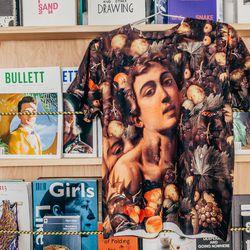 """<b>The Bullett Shop</b> Caravaggio T-Shirt, <a href=""""http://shop.bullettmedia.com/p/caravaggio-t-shirt/"""">$82</a>"""