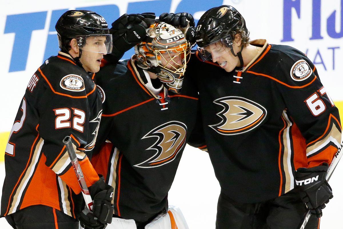 Shawn Horcoff, Anton Khudobin, and Rickard Rakell celebrate the Ducks win over the Wild on Sunday at Honda Center.
