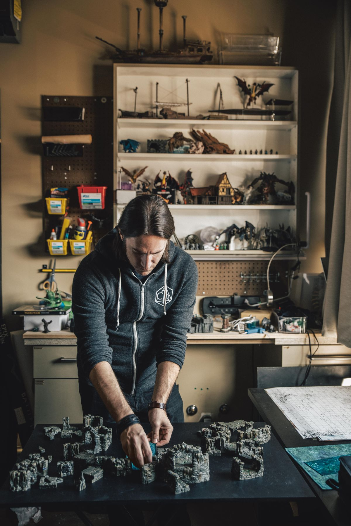 Matt Mercer prepares a map in his workshop for a D&D game on Critical Role