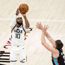Utah Jazz guard Mike Conley (10) shoots over Memphis Grizzlies center Xavier Tillman (2) during the game at Vivint Smart Home Arena in Salt Lake City on Friday, March 26, 2021.