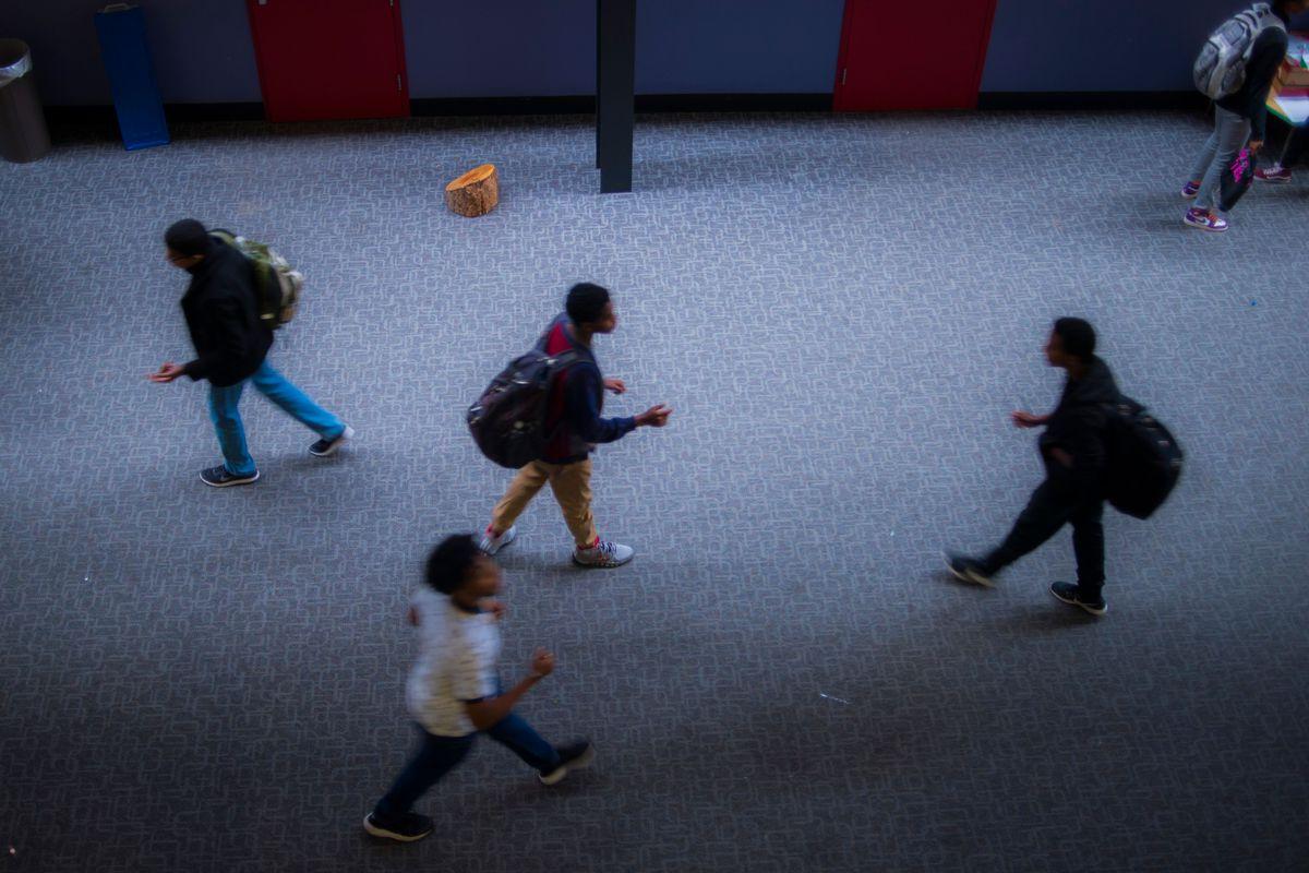 Students in a high school hallway.