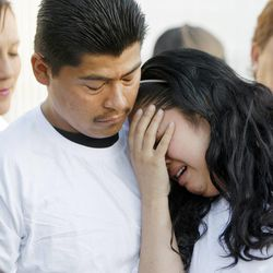 Ricardo Portillo's daughter, Johana Portillo-Lopez, is comforted by Juan Munoz as she talks about her father during a press conference Sunday, May 5, 2013 at the Portillo home. Her father died Saturday, May 4, from injuries sustained from being hit by a 17-year-old soccer player. Funeral services will be Wednesday.