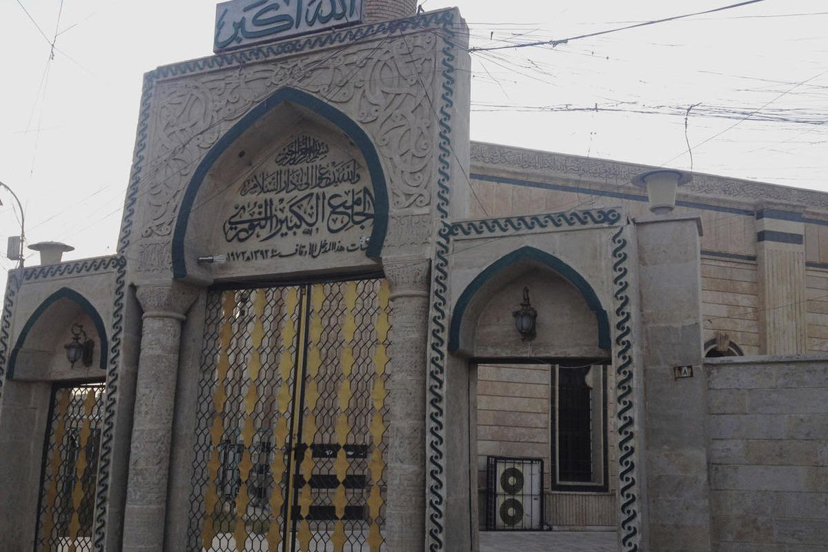 FILE - In this Sunday, July 6, 2014 file photo, the gate of the Great Mosque or al-Nuri Mosque is seen in the northern city of Mosul, Iraq. The Islamic State group destroyed Mosul's al-Nuri mosque and its iconic leaning minaret known as al-Hadba late Wedn