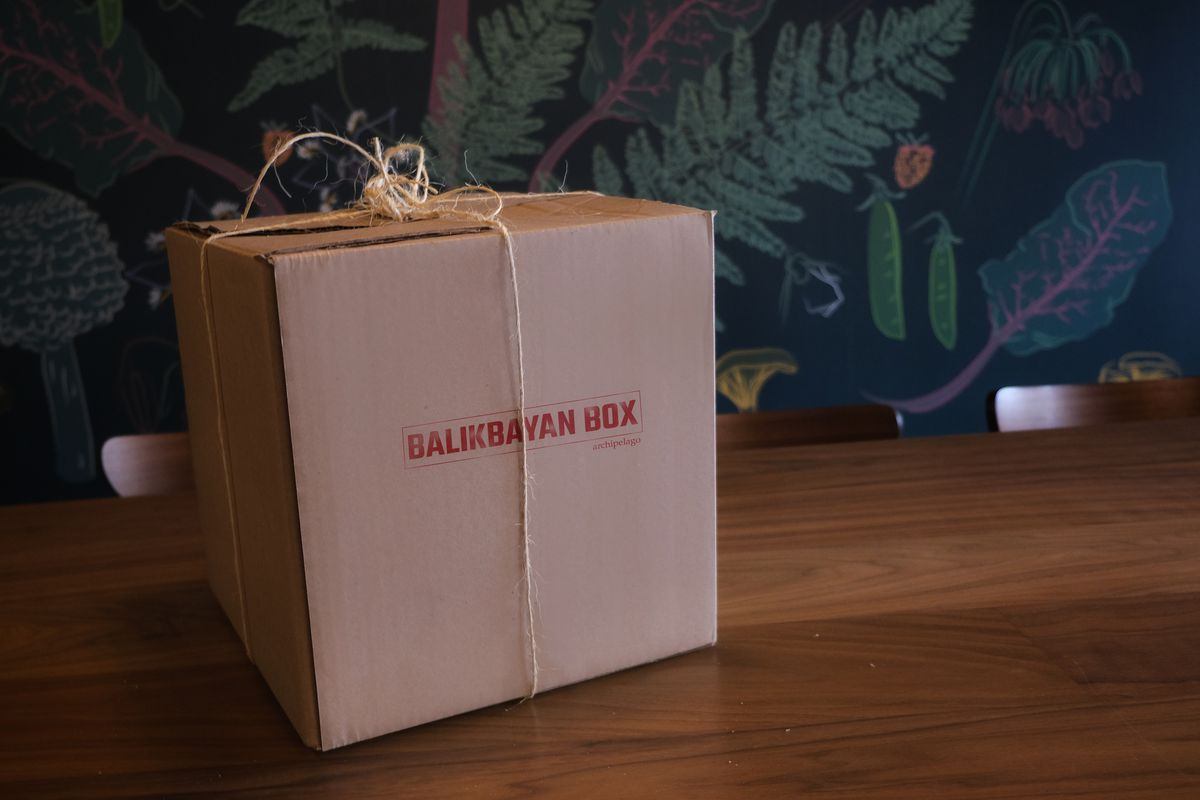 A cardboard Balikbayan box from Archipelago, tied with string