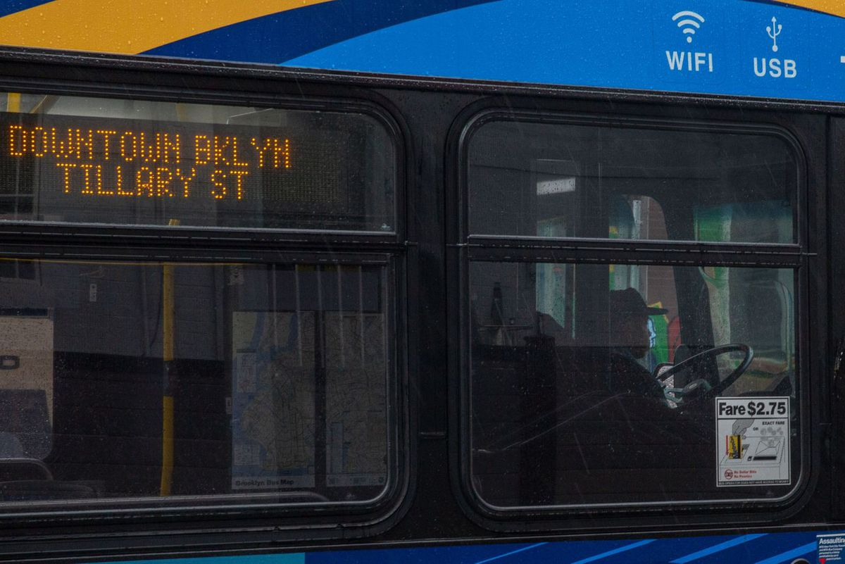 An MTA driver navigates a B26 bus in Bed-Stuy, Brooklyn, during the coronavirus outbreak.
