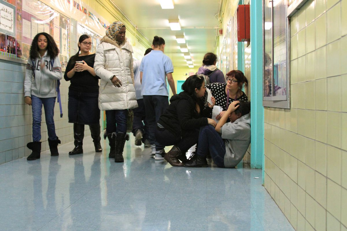Students and staff at M.S. 244 comfort an eighth-grader who did not get into the high school of her choice.