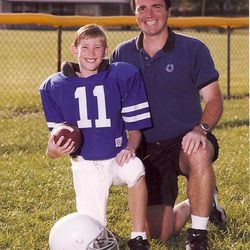 What might've been! Little Gordon Hayward poses in his Colts uniform (little league, not Indianapolis' NFL team) with his coach/dad.