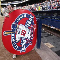 Atlanta Braves assistant grounds keeper Andrew Worrill carries a special Chipper Jones on deck circle to the field as he help prepare Turner Field for tribute to Atlanta Braves third baseman Chipper Jones  before a baseball game against the New York Mets in Atlanta, Friday,  Sept. 28, 2012. Jones plans to retire at the end of the season.