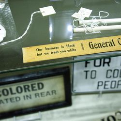 A display shows colored-only items at the Jim Crow Museum.