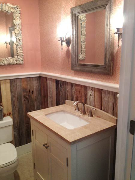 Natural wood panelling on the walls of a small bathroom.