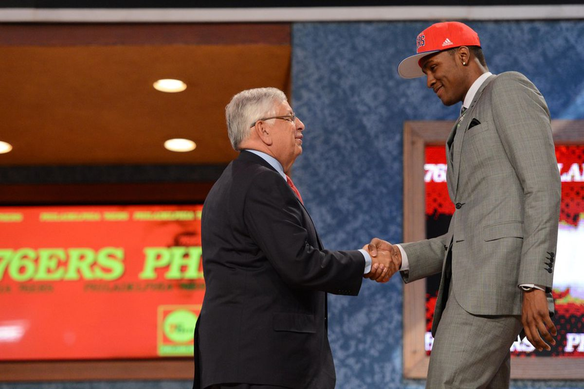 Maurice Harkless reaches out for David Stern's hand as a first-round NBA Draft pick, in a moment that all ballplayers dream about.