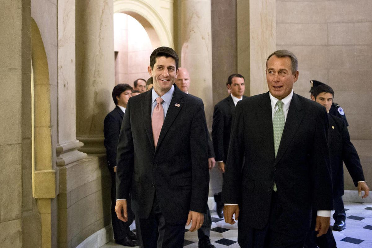 Walking with House Speaker John Boehner, R-Ohio, right, Rep. Paul Ryan, R-Wis., left, the Republican vice presidential candidate, returns to Capitol Hill to vote on a stopgap spending bill that avoids a government shutdown but carries a price tag $19 bill