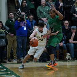 St. Patrick's Dominic Galati (22) makes his way around Notre Dame's Anthony Sayles (2), Friday 02-08-19. Worsom Robinson/For the Sun-Times.