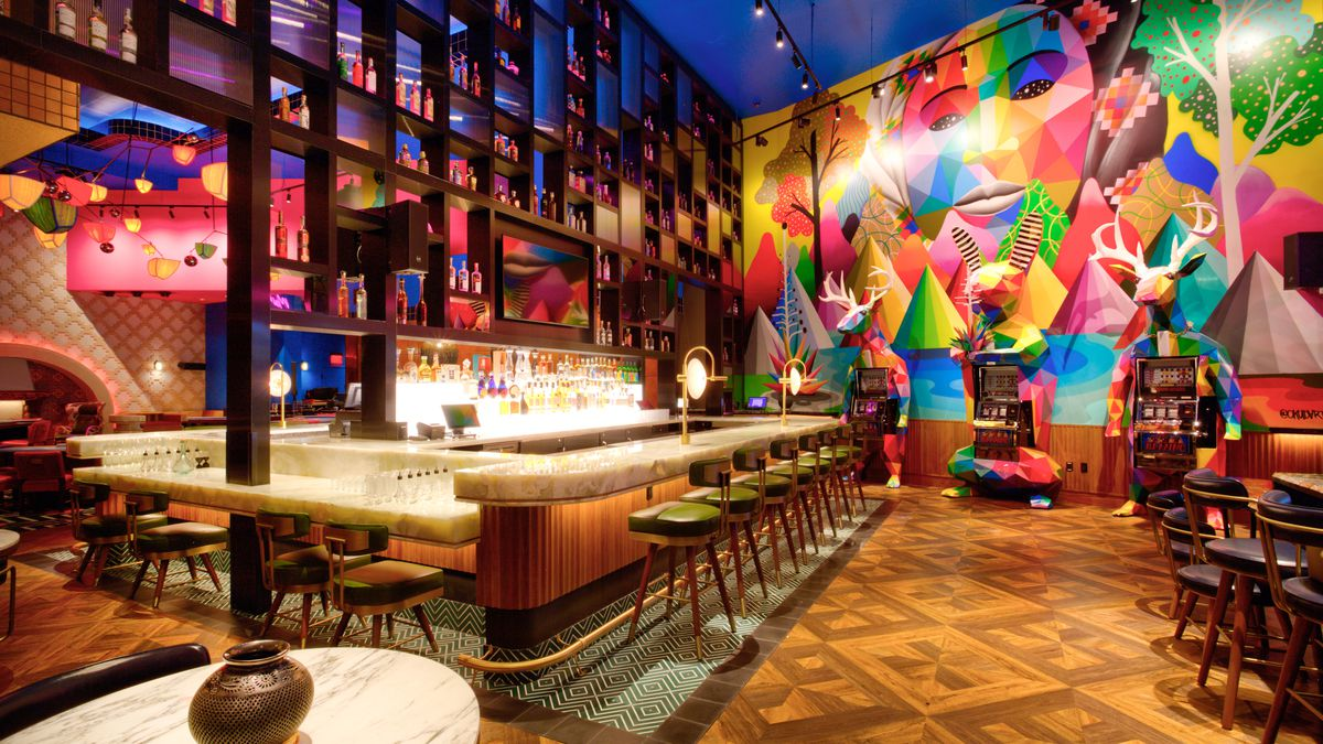 A bar with a colorful mural