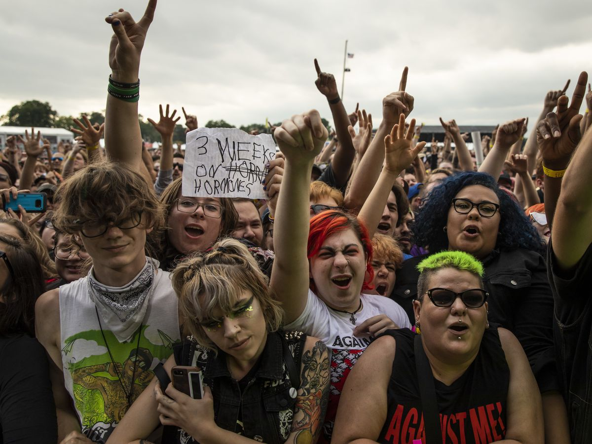 Fans cheer as Against Me! performs on day three of Riot Fest in Douglas Park, Sunday afternoon, Sept. 15, 2019.