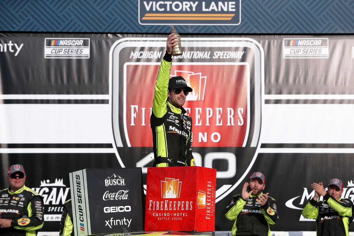 Ryan Blaney, driver of the #12 Menards/Cardell Cabinetry Ford, celebrates in the Ruoff Mortgage victory lane after winning the NASCAR Cup Series FireKeepers Casino 400 at Michigan International Speedway on August 22, 2021 in Brooklyn, Michigan.