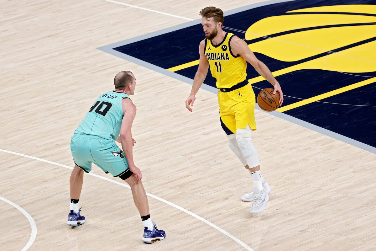 Domantas Sabonis of the Indiana Pacers dribbles the ball while being guarded by Cody Zeller of the Charlotte Hornets in the second quarter at Bankers Life Fieldhouse on April 02, 2021 in Indianapolis, Indiana.