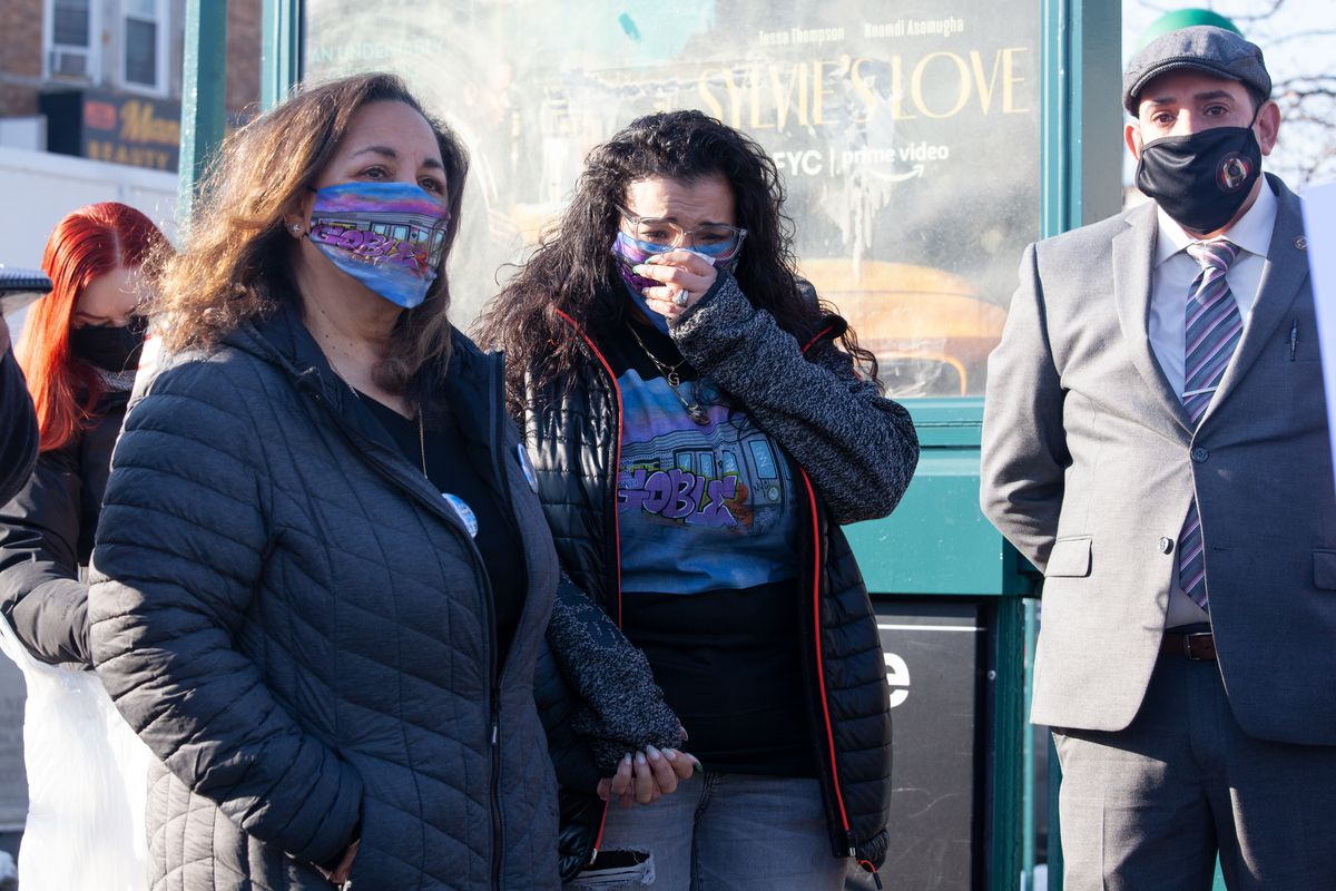 Garrett Goble's mother, Vicki (left), and widow, Delilah Rodriguez Goble, attend a memorial ceremony at the Flatbush Avenue-Brooklyn College station, Dec. 21, 2020.