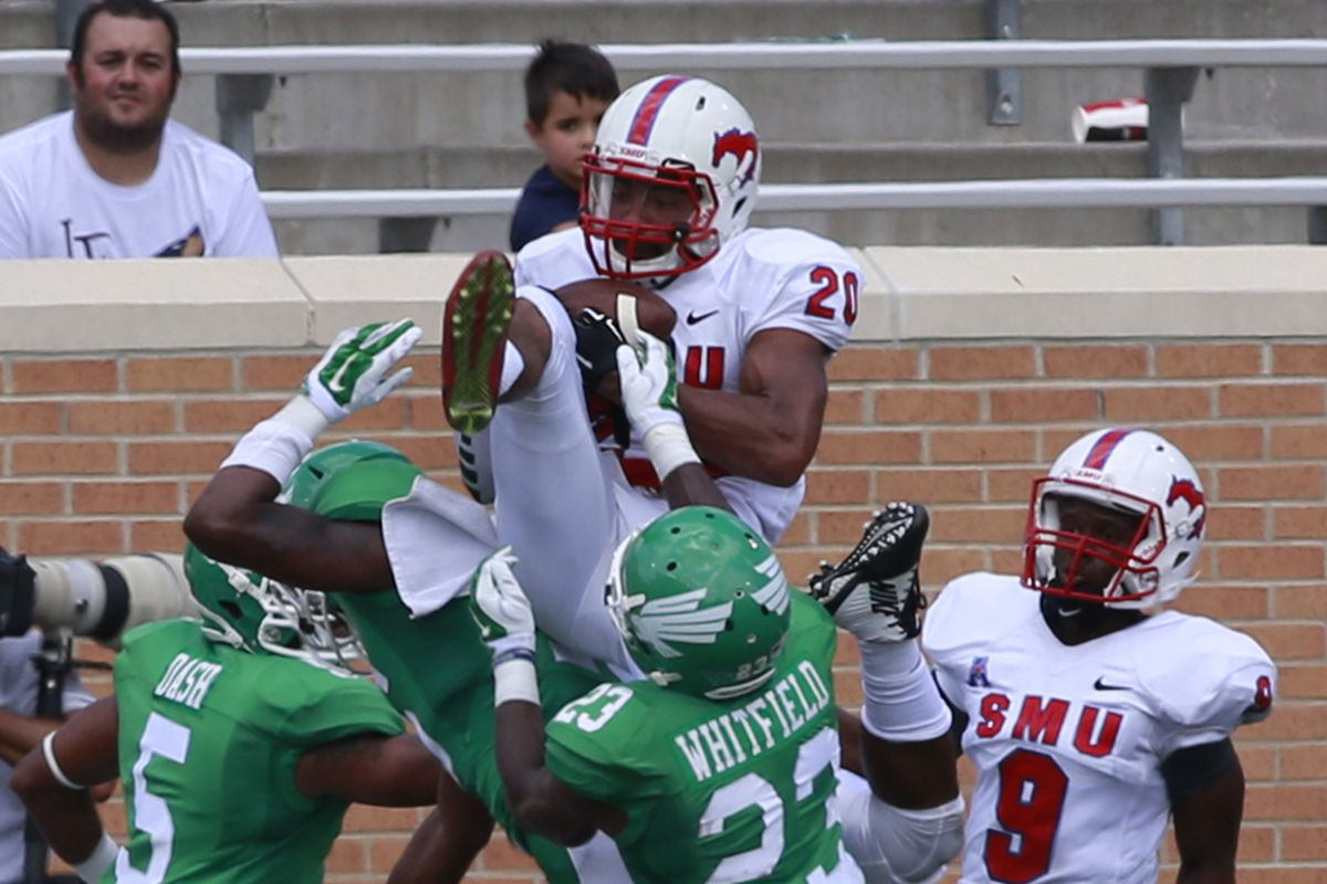 SMU leaps for a hail mary pass in the 2014 matchup.  Will 2015 be a blow-out, or could the game come down to just one big play?