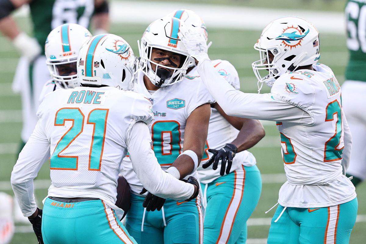 Nik Needham #40 of the Miami Dolphins celebrates after intercepting a pass by Sam Darnold #14 of the New York Jets during their NFL game at MetLife Stadium on November 29, 2020 in East Rutherford, New Jersey.
