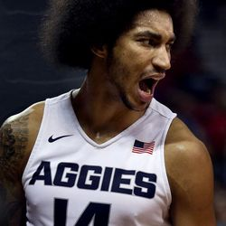 Utah State Aggies Jalen Moore screams after scoring against San Jose State Spartans at the Mountain West Men's Basketball Championships at the Thomas & Mack Center, Las Vegas, Nevada on Wednesday, March 8, 2017.