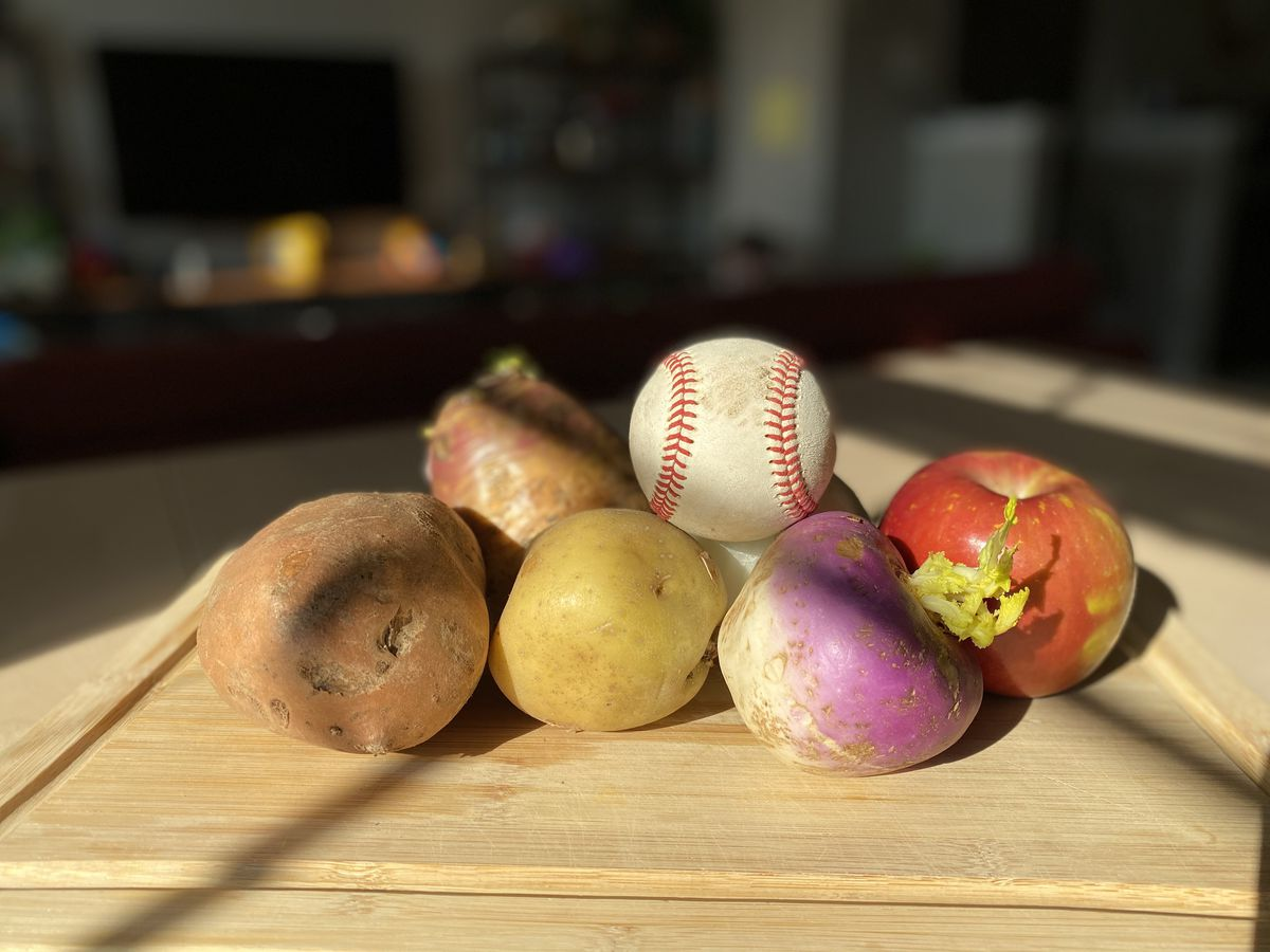 A baseball and some vegetables.