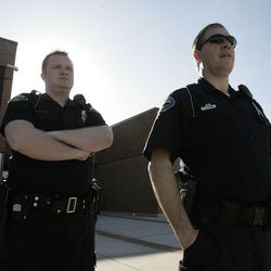 Sandy police officers stand outside Alta High School in Sandy on Tuesday, March 29, 2011. The school's principal and assistant principal have been placed on administrative leave.