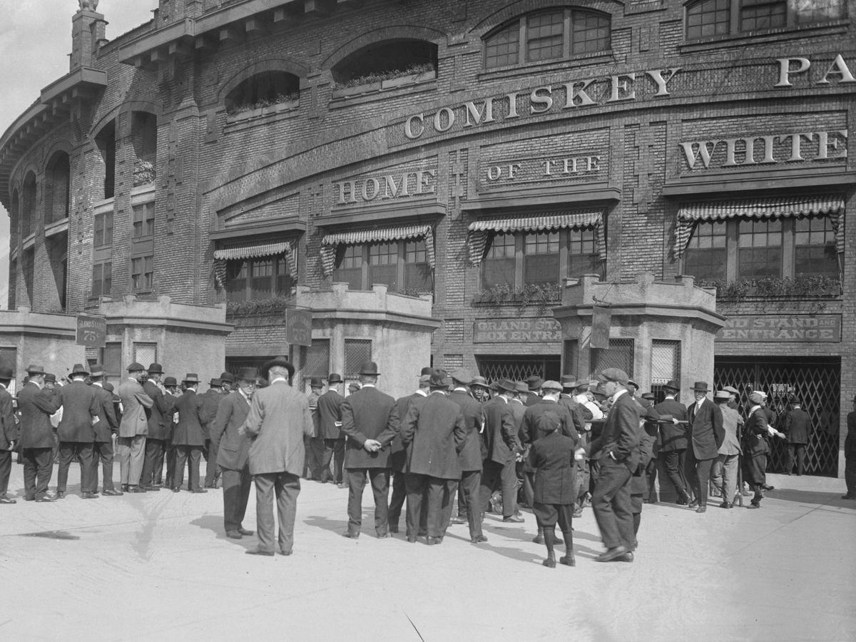 Men standing in lines at ticket booths for the National League's Chicago Cubs and American League's Chicago White Sox City Series games at Comiskey Park, Chicago, Illinois, 1914.