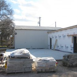 This area will be covered with a canopy, and will have drop-down walls and heaters for winter.