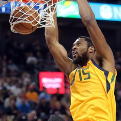 Utah Jazz forward Derrick Favors (15) dunks the ball during a basketball game against the Indiana Pacers at the Vivint Smart Home Arena in Salt Lake City on Monday, Jan. 15, 2018.