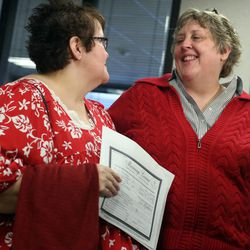 Shelly Eyre, left, and Cheryl Haws speak to reporters after receiving a marriage license from the Utah County Clerk's Office in Provo on Thursday, Dec. 26, 2013. Eyre and Haws served the Utah County Clerk's Office with a lawsuit Monday after the clerk's office refused to grant them a marriage license. The Utah County Clerk released a statement this morning saying that based upon Judge Robert Shelbys denial of a stay, marriage licenses will be issued to all eligible applicants in Utah County.
