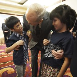 President Russell M. Nelson of The Church of Jesus Christ of Latter-day Saints meets with multigenerational families in Jakarta, Indonesia, on Nov. 21, 2019.