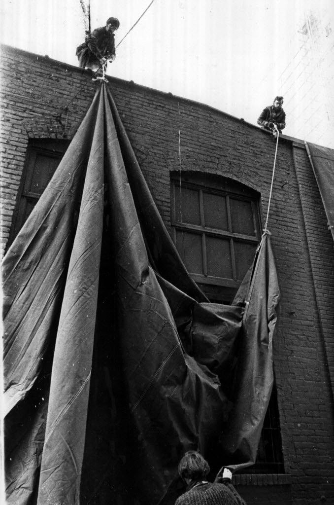 Artist Christo (bottom, foreground, with his team) goes about his work of wrapping the Museum of Contemporary Art with 10,000 square feet of tarpoline in 1969.   Bob Black/Sun-Times/File