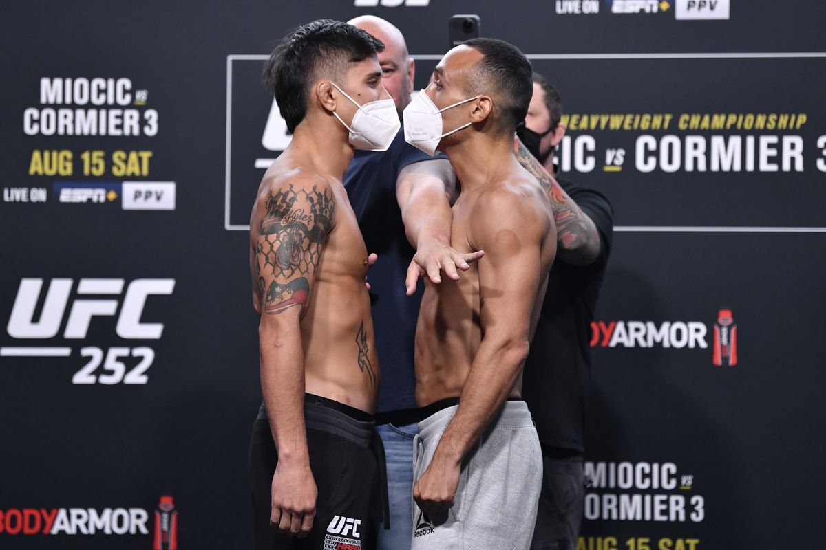 Opponents TJ Brown and Danny Chavez face off during the UFC 252 weigh-in at UFC APEX on August 14, 2020 in Las Vegas, Nevada.