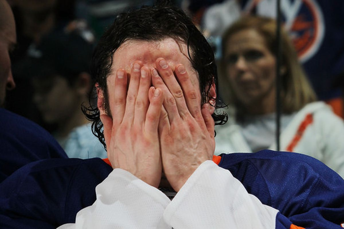 Mark Streit prepares to uncover his eyes and see the contract he just won.