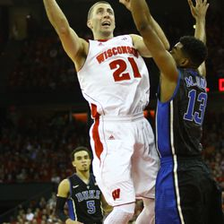 Josh Gasser goes up for a contested layup