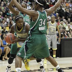 Baylor forward/center Destiny Williams (10) looks for a way around Notre Dame forward Markisha Wright (34) during the first half in the NCAA women's Final Four college basketball championship game, in Denver, Tuesday, April 3, 2012.  (AP Photo/Eric Gay)