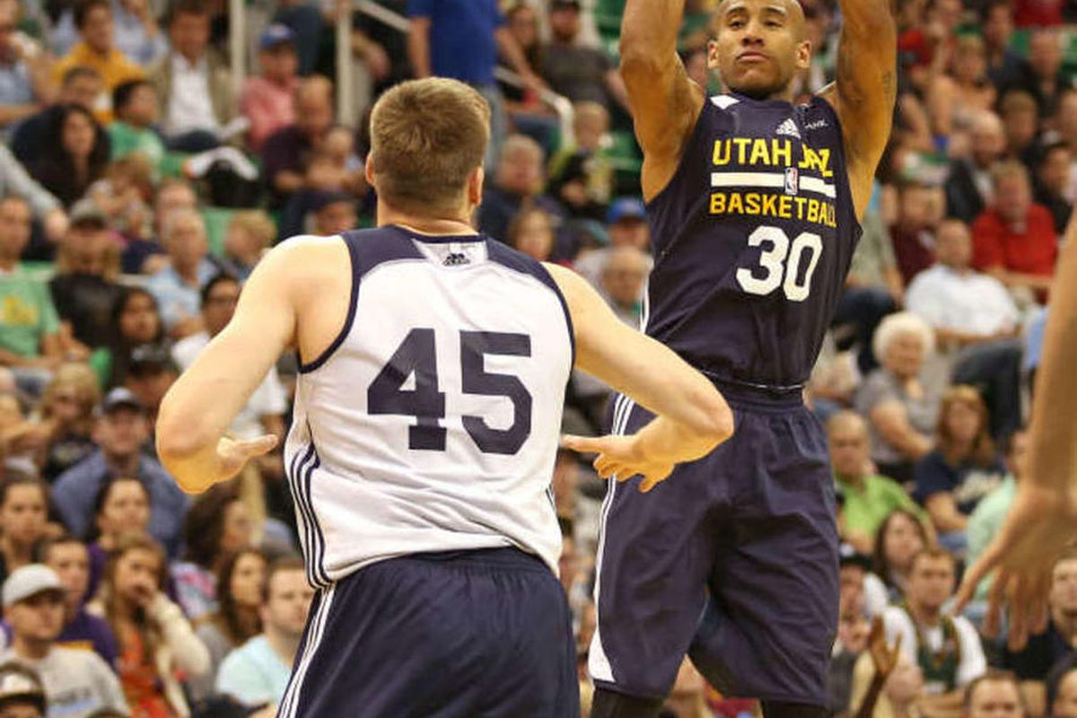 Utah's Dahntay Jones shoots as the Utah Jazz hold a public scrimmage before heading into pre-season games Monday, Oct. 6, 2014, in Salt Lake City.