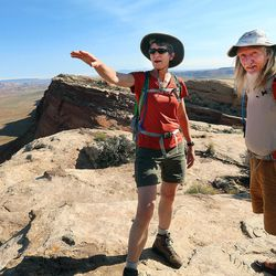 Interior Secretary Sally Jewell, talks with guide Vaughn Hadenfeldt on Comb Ridge as she visits rock art sites, some of which have been vandalized in southern Utah on Saturday, July 16, 2016.