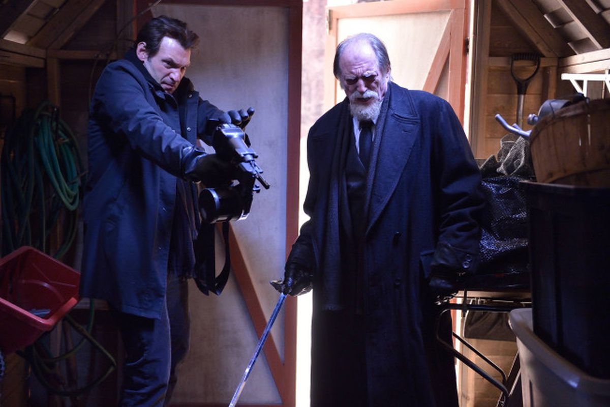 Armed with only a nail gun and a sword, Eph (Corey Stoll, left) and Setrakian (David Bradley) track down vampires.