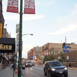 Mixture of street banners, on the 3700 block of Clark Street. The neighborhood association must have run short of Cubs banners