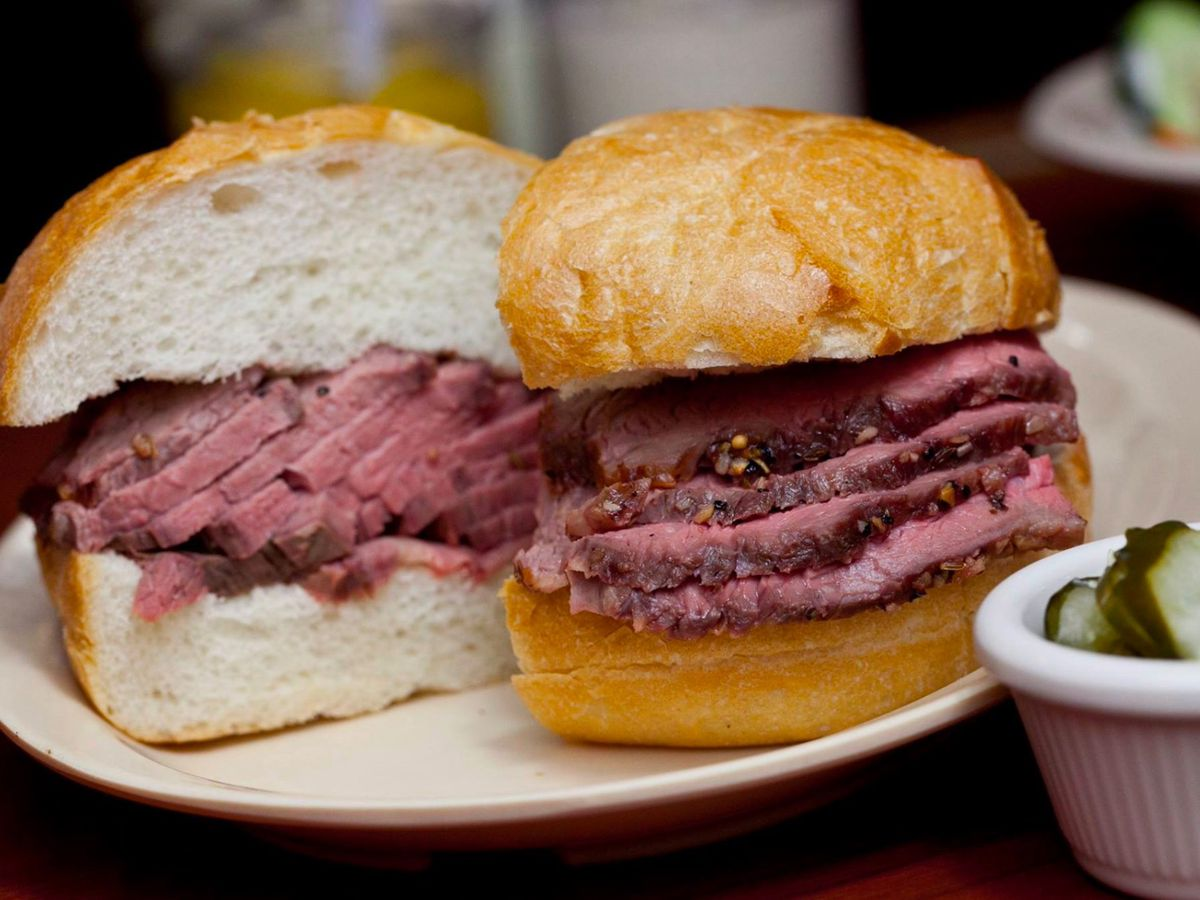 Tri-tip sandwich with a side of pickles