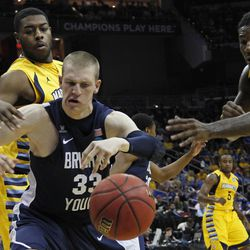 BYU forward/center Nate Austin (33) fights for a loose ball with Marquette forward Davante Gardner, left, and Marquette forward Jae Crowder (32)in the first half of their NCAA tournament second-round college basketball game in Louisville, Ky., Thursday, March 15, 2012. (AP Photo/Dave Martin)