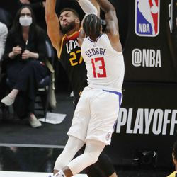 Utah Jazz center Rudy Gobert (27) defends LA Clippers guard Paul George (13) during the NBA playoffs in Salt Lake City on Thursday, June 10, 2021. The Jazz won 117-111.