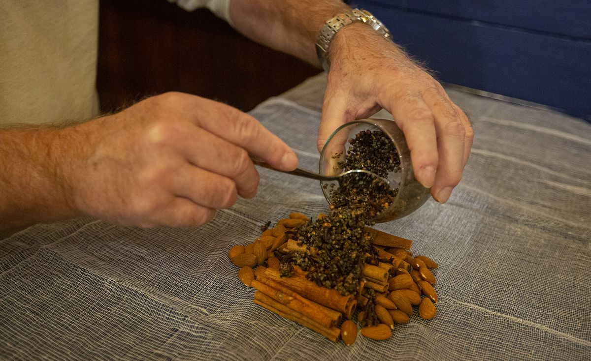 Two hands mixing spices.