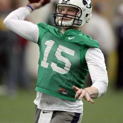 Ammon Olsen throws a pass during BYU spring football practice at BYU in Provo on Friday, March 22, 2013.